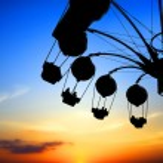 Amusement park at sunset — Stock Photo
