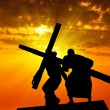Dragging a wooden cross — Stock Photo