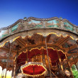 Vintage carousel at sunset in Paris - Stock Photo