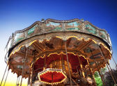 Vintage carousel at sunset in Paris — Stock Photo