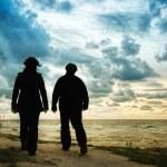 Couple walking on beach — Stock Photo #9195390