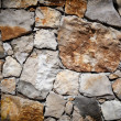 Medieval stone wall background or texture - Stock Photo