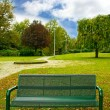 Green bench in the park — Stock Photo #9461452
