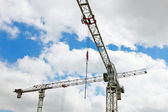 Hoisting crane on blue sky — Stock Photo