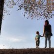Happy active family in autumn park — Stockfoto