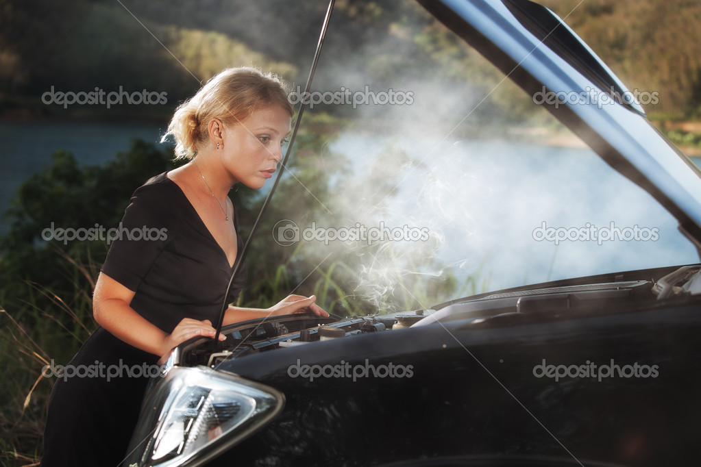 Portrait of young beautiful woman with broken car aside — Stock Photo #8858842