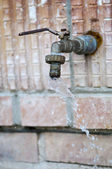 Water flowing from the old tap — Stock Photo