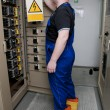 Electrician in the electrical distribution — Stock Photo #10707406