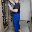 Stock Photo: Electrician in the electrical distribution