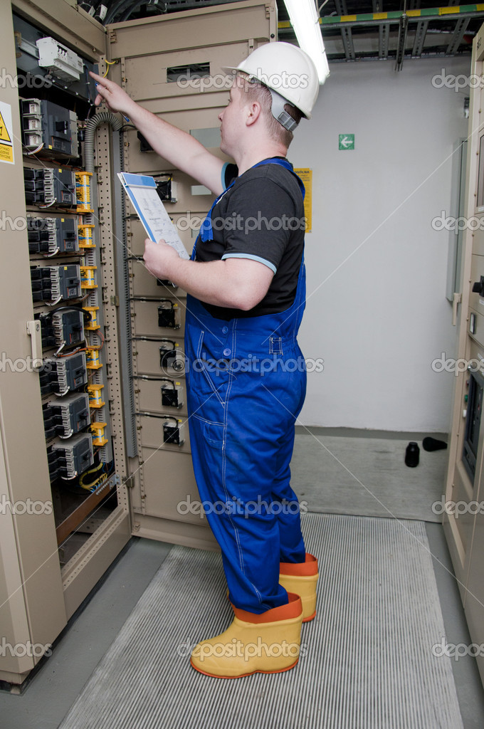 Electrician in the distribution of electricity in protective clothing  Stock Photo #10707570