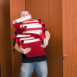 Man carrying the binders — Stock Photo
