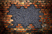 Hole in an old brick wall — Stock Photo