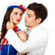 Elegant young man and beautiful sailor woman - Stock Photo