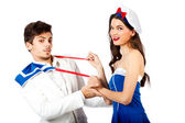 Sexy sailor woman seducing elegant young man — Stock Photo