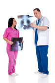 Two doctors looking at radiography — 图库照片