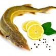 Fish starlet with lemon and pepper — Stock Photo #10369852