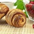 Croissants with berries — Stock Photo
