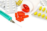 Capsule red with drugs and a syringe — Stock Photo
