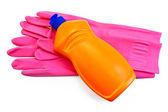 Butelka pomarańczowy różowy gumowe rękawiczki — Zdjęcie stockowe