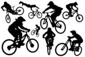 Cyclist silhouettes — Stock Vector