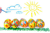 Child's picture by a water-colour: five easter eggs on a grass, — Stock Photo