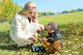 The young woman with the son on walk — Stock Photo
