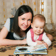 Stock Photo: Mother reading to daughter