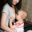 Mother breast feeding baby — Stock Photo #9579482