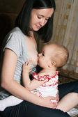 Mother breast feeding baby — Stock Photo