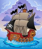 Pirate ship in stormy sea — Stock Vector