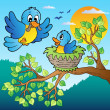 Two blue birds with tree branch - 图库矢量图片