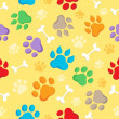 Stock Vector: Seamless background with paws 1