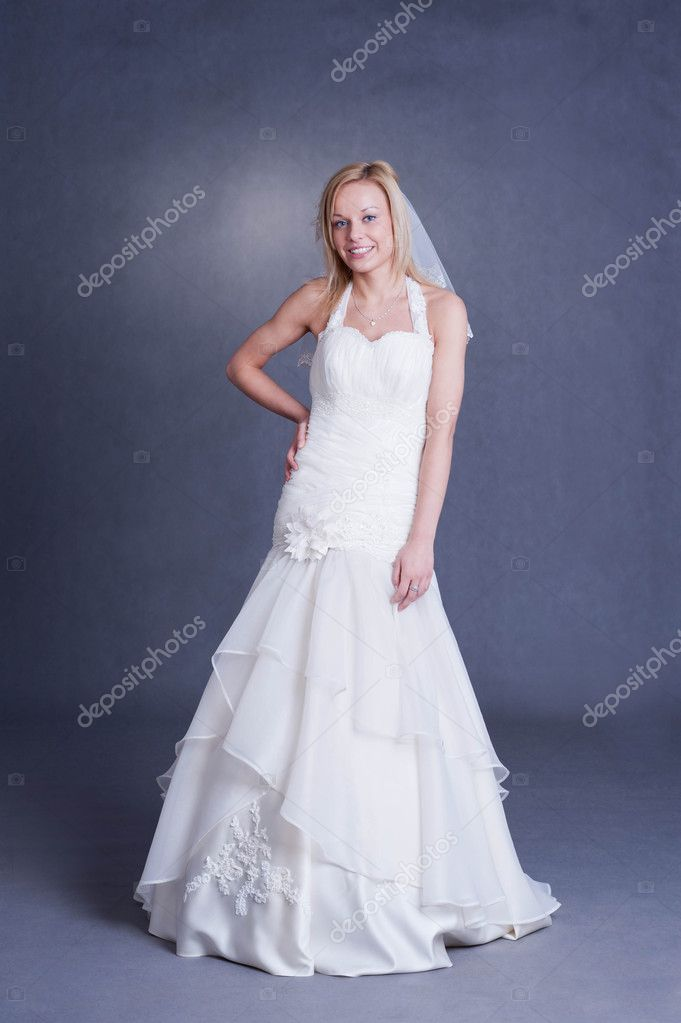 Beautiful girl in wedding dress on grey background - studio shot — Stock Photo #9165786
