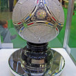 Metal brilliant football ball under glass box, EURO 2012 object. - Stock Photo