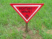 Ahtung minen as text on german language, danger sign warning. — Stock Photo