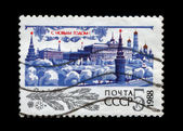 USSR - CIRCA 1987: Kremlin with red star, trees under snow for New Year. — Stock Photo