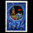 Foto de Stock  : USSR - CIRC1973: Kremlin tower with red star, red USSR flag.