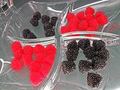 Fresh red raspberries, black blackberries in glass plate. — Stock Photo
