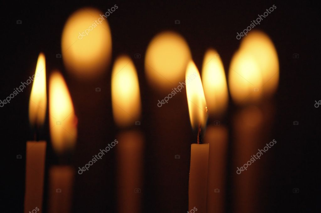 Discounted wax candles in the church. Background for design — Stockfoto #10464669