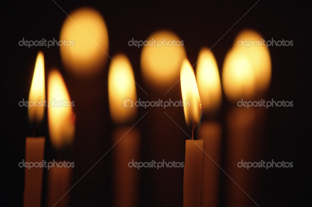Discounted wax candles in the church. Background for design  Stok fotoraf #10464669