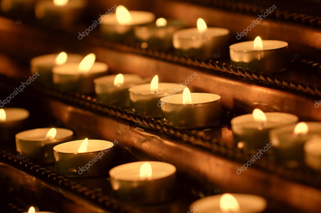 Discounted wax candles in the church. Background for design — Stock Photo #10464677