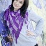 Teen girl near graffiti wall — Stock Photo #10287476