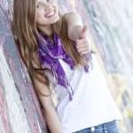 Style teen girl near graffiti wall. — Stock Photo #10287486