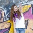 Royalty-Free Stock Photo: Style teen girl near graffiti wall.