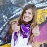 Style teen girl near graffiti wall. — Stock Photo #10287549
