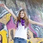 Style teen girl near graffiti wall. — Stock Photo #10287555