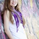 Style teen girl near graffiti wall. — Stock Photo #10287571
