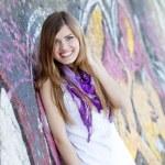 Style teen girl near graffiti wall. — Stock Photo #10287592