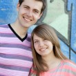 Young couple near graffiti background. — Stock Photo