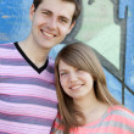Young couple near graffiti background. — Stock Photo #10402219
